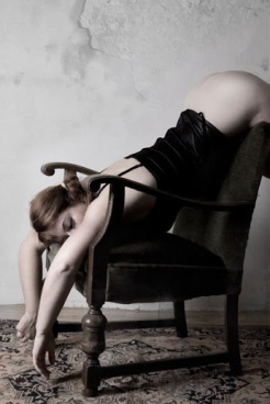 draped over chair